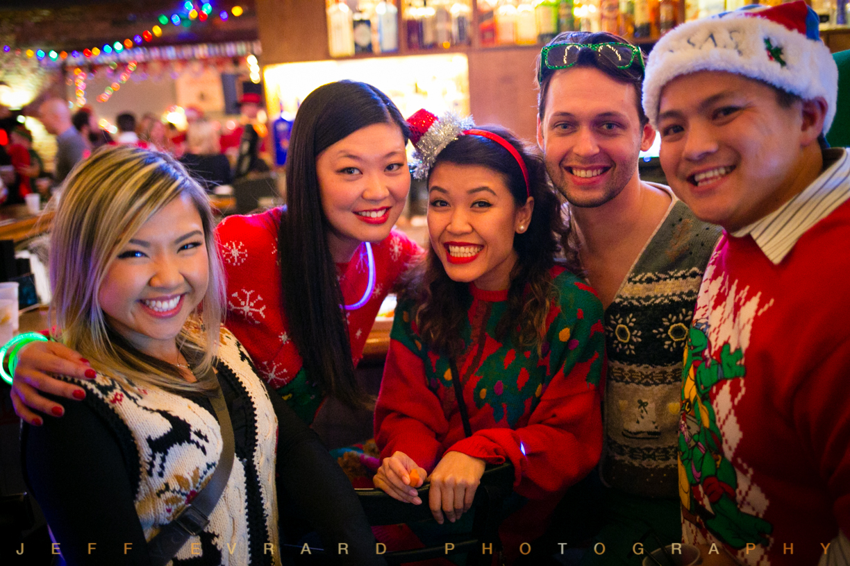 A group of people at The Ugly Christmas Sweater Party